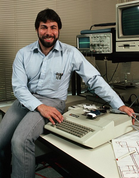 ca. May 23-May 27, 1986, Cupertino, California, USA --- Steve Wozniak, designer of the Apple II, sits with one of the machines, which was the most successful personal computer of its day. --- Image by © Roger Ressmeyer/CORBIS
